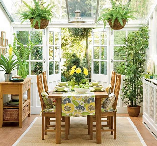 Sun Room Dining With Indoor Plants Surrounded By Lush Greenery