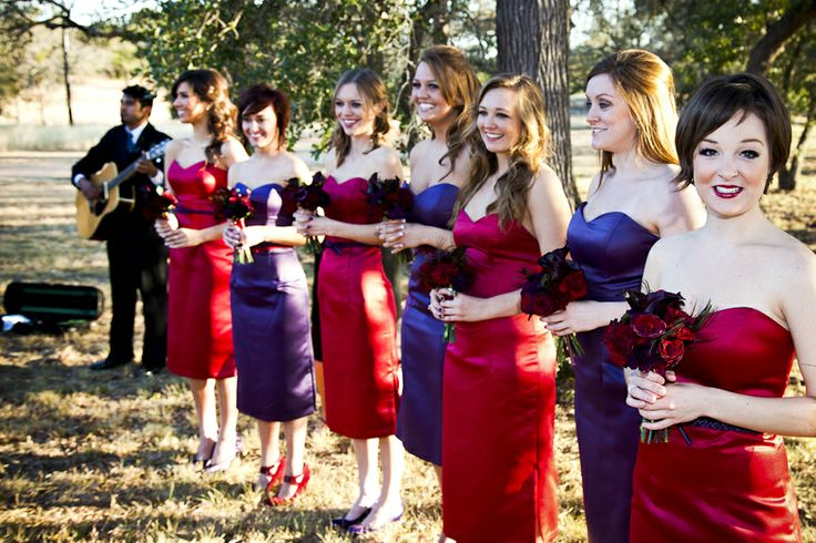 be whimsical and bold by having your bridesmaids wear purple and red