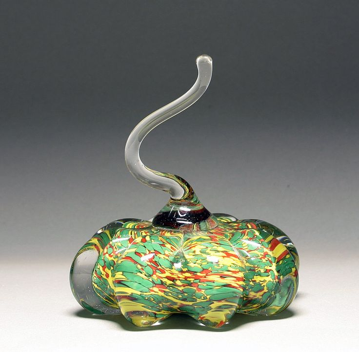 Speckled Green Pumpkin by Scott Summerfield. A solid, blown glass pumpkin, speckled with colored glass, and featuring a hand-shaped stem.