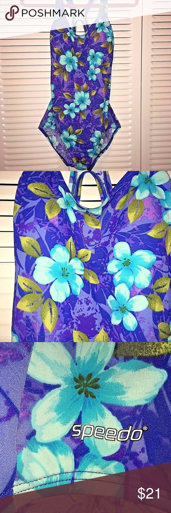"""Speedo One-piece Swimsuit Blue Purple Floral Print Racer-back cut straps on upper back. It is fully lined. Measurements: armpit to armpit 16"""". Length from top of strap to bottom hem: 29"""". Thank you for checking out my Closet and please feel free to ask any questions. I consider all reasonable offers Speedo Swim One Pieces"""