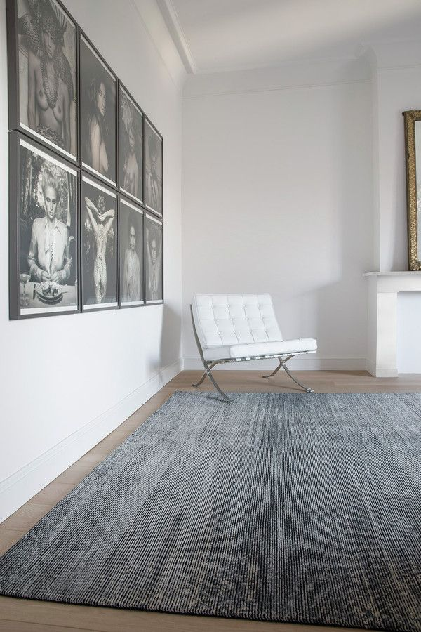 black anthracite rugs white wooden floor white wall