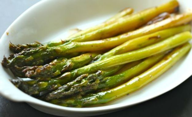 Braised Asparagus Recipe Side Dishes with vegetable oil, asparagus, ground black pepper, kosher salt, low sodium chicken stock, unsalted butter