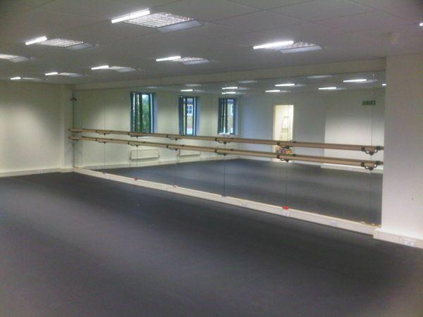 installation of ballet barres studio mirrors dance floors studio