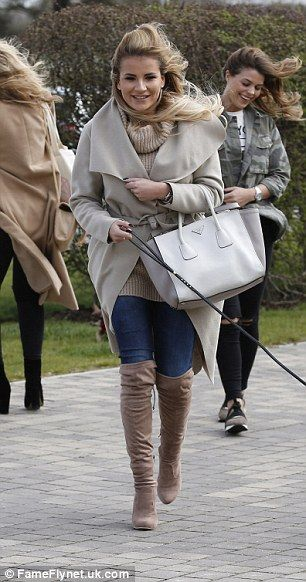 Dog walker chic: Georgia Kousoulou wrapped up in a cosy coat which she wore over skinny je...