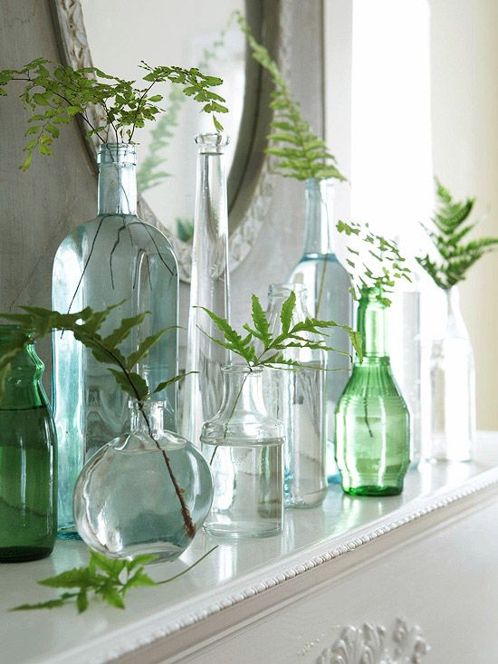 Resourceful Recycling...Recycle a collection of glass bottles into an eye-catching mantel display. Gather interesting greenery from outdoors and place each piece in a different jar. Stagger jars according to shape and height, then place a mirror behind the collection to reflect light.