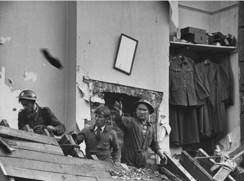 1940 London at War - Rescue Workers    London 1940 Rescue workers clearing the ruins of buildings destroyed during German air attack against the city.