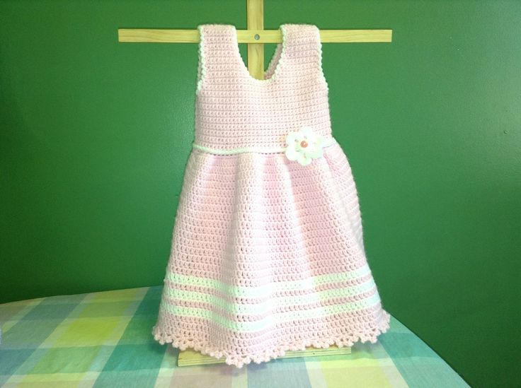 This Youtube video teaches you how to crochet a super simple pink baby dress.  It is a great one for beginners to try.