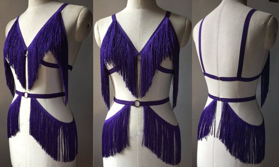 Shimmy on with this gorgeous burlesque costume! Elastic cage bra and belt with swingy fringe in a variety of colours. Open style bra (with no cup fabric) perfect for wear with pasties. Ideal for go-go dancing, as the straps are a great place for tip-tucking! Either black or white closure at back. Designed to reveal, not conceal! Fringe swings and sways as you dance.  Choose one colour at checkout. Made to order. The default style of the bra is with bra straps. If you prefer a halter style…