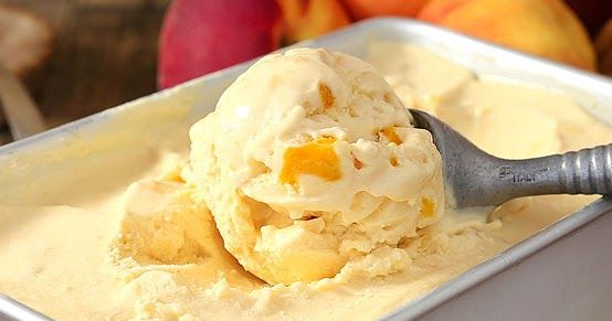No-Churn 2-Ingredient Peaches & Cream Ice Cream is rich, thick and amazingly delicious. And it does NOT use sweetened condensed milk. This glorious ice cream is speckled with fresh peaches and it's so good you may never get store bought again! This simple recipe comes together in a flash and is sure to be your go-to summer ice cream recipe.