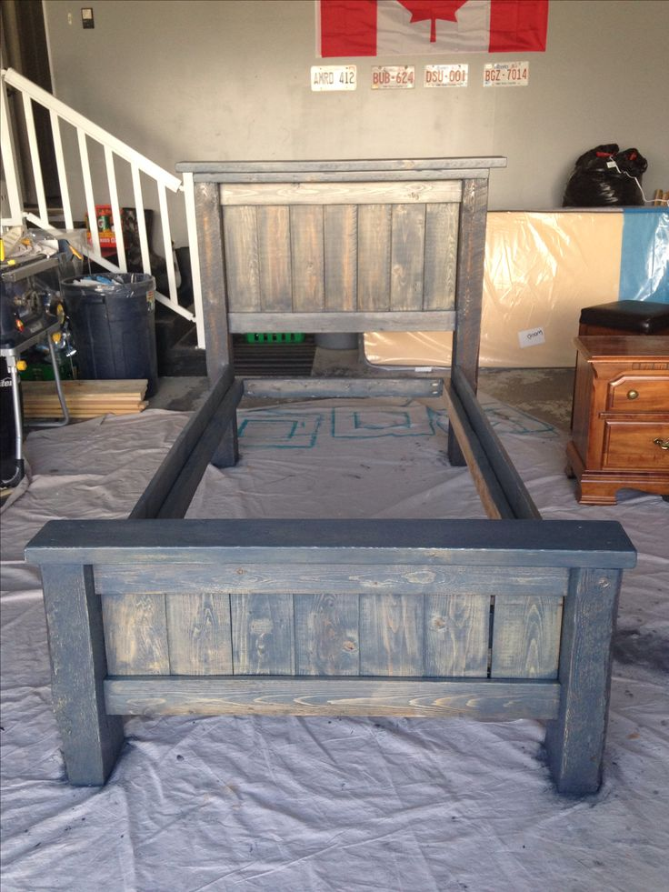 DIY twin bed frame.  Plans from Anna White.  Stained in Minwax Charcoal Grey.  Total cost for project $80 :)
