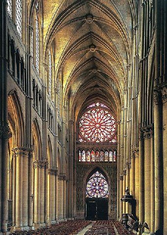Reims Cathedral interior, France (High Gothic) note the large rose window and the small rose window - roses symbolic of the virgin Mary whose roles at the time were Mary Mother of God, Mary Queen of Heaven, and Mary the Merciful Intercessor