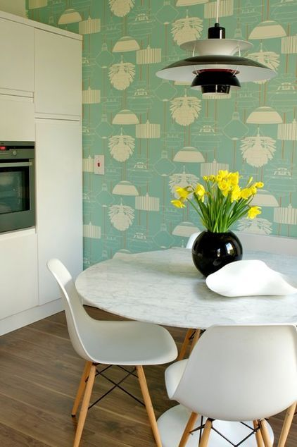 Kitchen - wallpaper & tulip table.  Love the idea of a wallpapered accent wall.