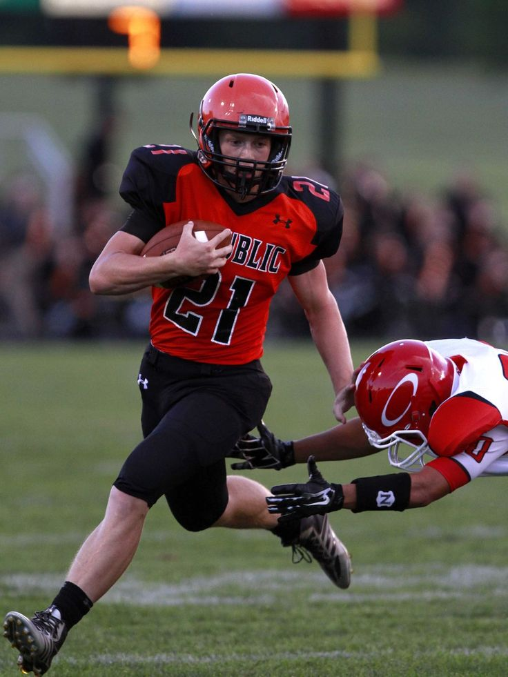 Republic Tigers running Jerney Jonesback carries the ball as Ozark defensive back misses a tackle during a game Republic on Friday, Sept. 5, 2014.