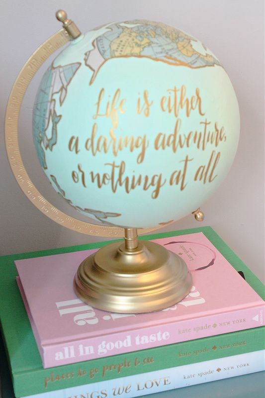 "hand painted globe with quote: ""Life is either a daring adventure or nothing at all"""
