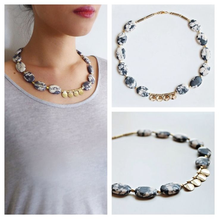 A gorgeous necklace featuring gold tone pieces and Zebra Jasper stones