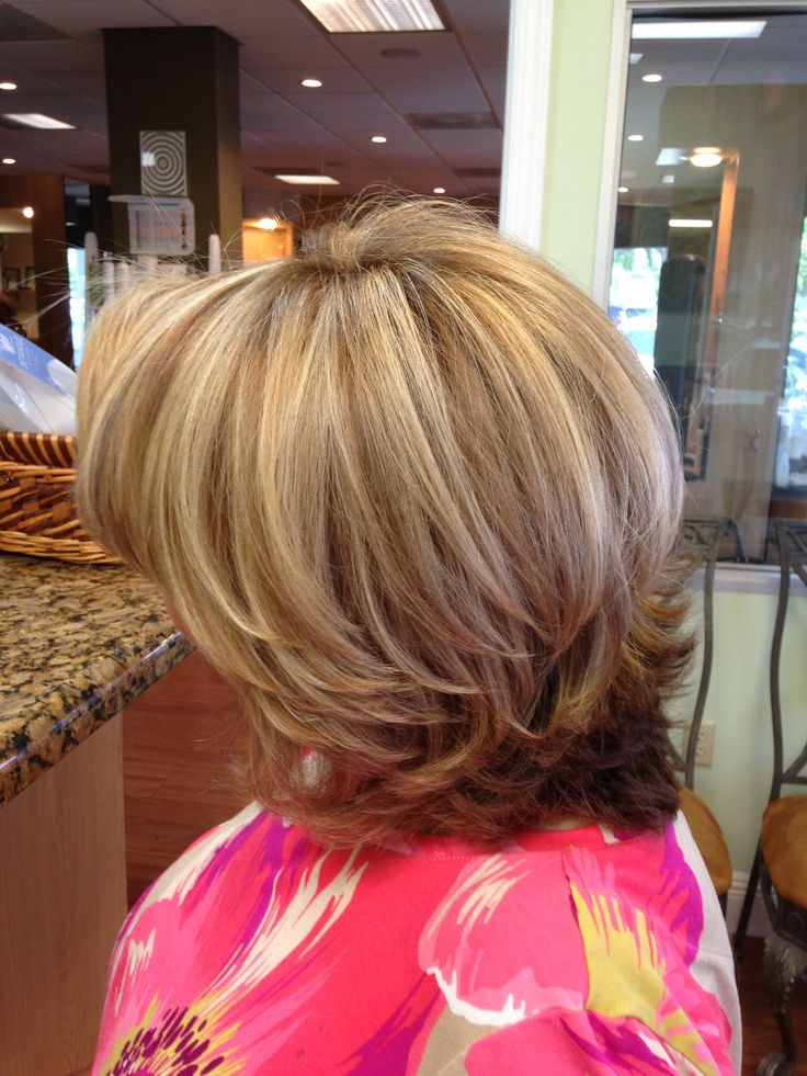 Lots of layers and highlights for this beautys hair. Filled with shine, contrasting color and style