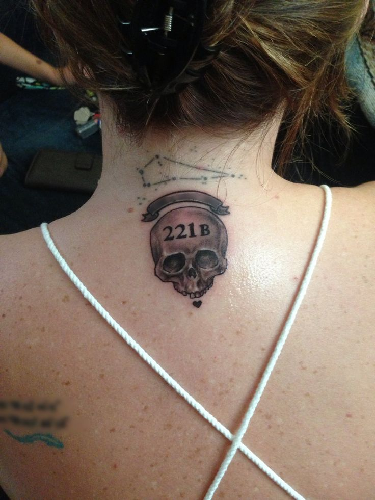 Self designed Sherlock tattoo ❤ skull for Sherlock, heart for John. Banner has a Sherlock quote that I blurred out