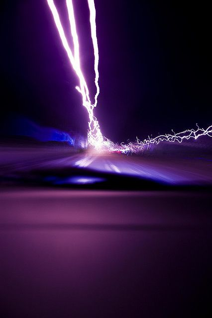 Seeing lightning strike from a moving car...Photo by domestik, via Flickr