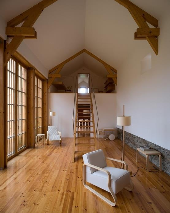 barn house with loft design to create separate study on mezzanine floor