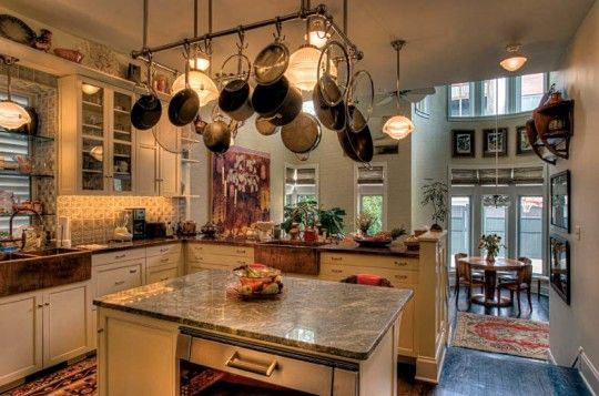 """An Art Nouveau Town House Makeover  """"Kitchen, with holophane-style lights and farmhouse sinks, opens onto the breakfast room."""""""