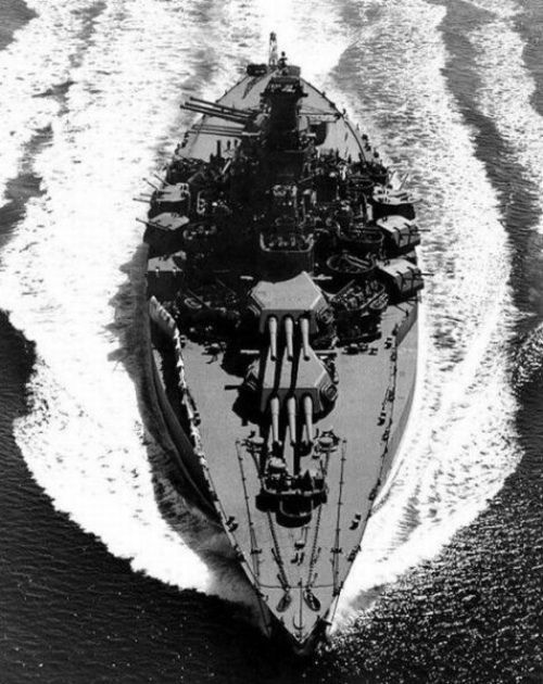 A South Dakota Class US Battleship (based on her single funnel). Only four of her class were built, USS South Dakota (BB-57), USS Indiana (BB-58), USS Massachusetts (BB-59), USS Alabama (BB-60). Without being able to see her hull number I can't positively identify her. ~redjeep