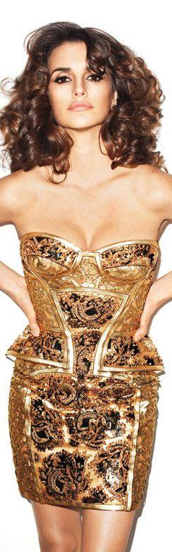 Penelope Cruz in a gold corset dress