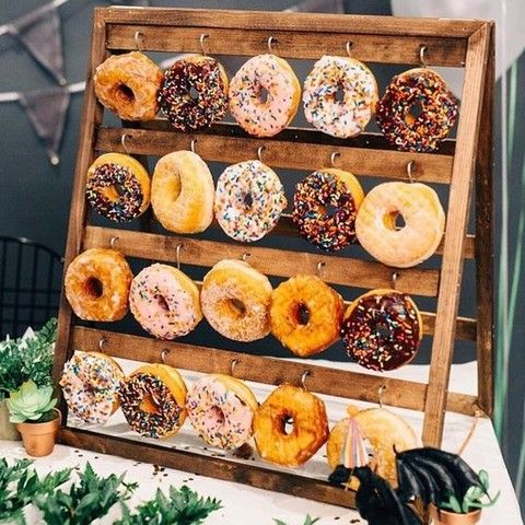 Donuts are loved by everyone! They are delicious and budget-savvy, so you should definitely serve them at your wedding! Create a donut bar ...