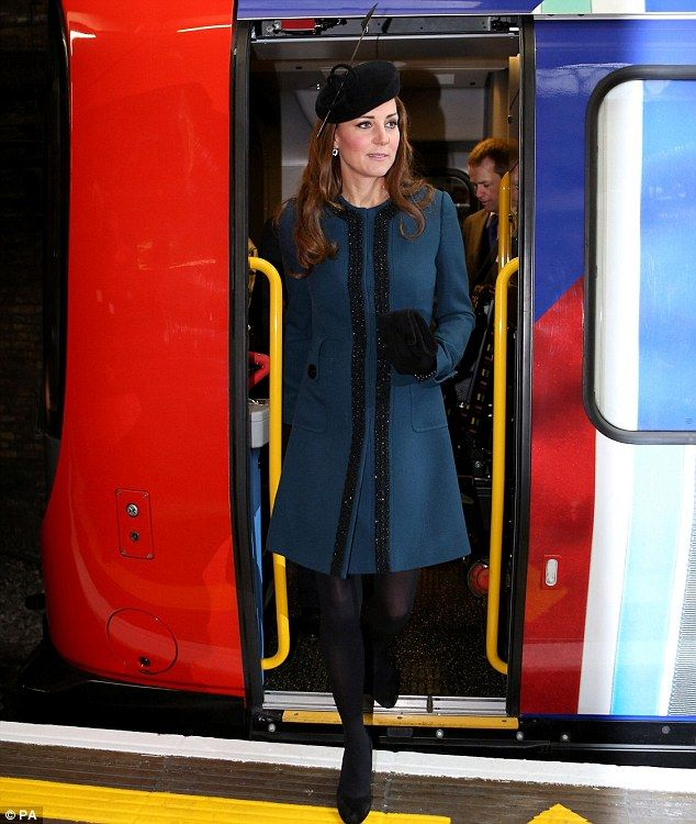 The Duchess of Cambridge, Kate Middleton, steps off the new S7 train running on the Metropolitan line.