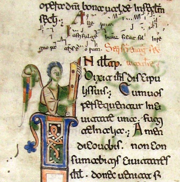 Ангел- символ Евангелиста Матвея. The Evangelist symbol of Matthew, an Angel Historiated initial 'I' on a leaf from a Missal in Beneventan script Italy, Puglia, 11th century