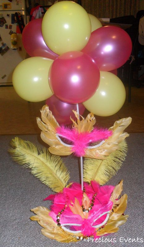masquerade party centerpiece- different colors... But an idea