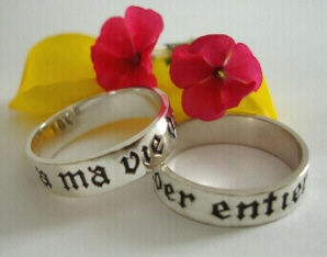 """History: A ma vie de coer entier french poesy ring translates """"my whole heart for my whole life."""" This poesy phrase is perfect for a wedding ring, inscribed on a simple sterling silver, 14K Yellow or White gold band in ancient French letter forms. French was commonly known as the language used by the Nobility throughout the Middle Ages. This beautifully inscribed ring personifies the love which people everywhere express for each other."""