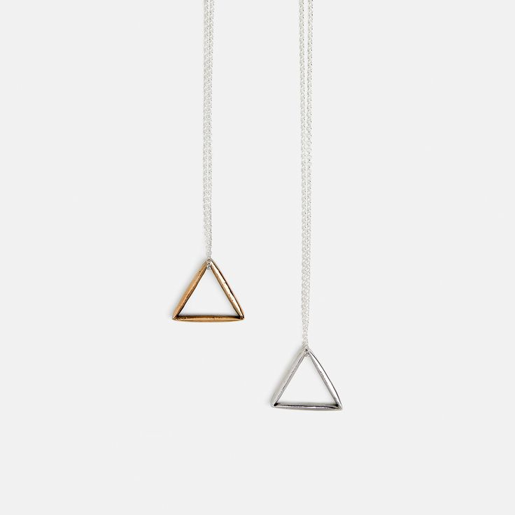 Simple triangle necklace. Sterling silver or bronze triangle on sterling silver chain.  Chain length is 65 cm and the triangle is 3 cm wide. All orders come in SIGNED jewellery boxes.