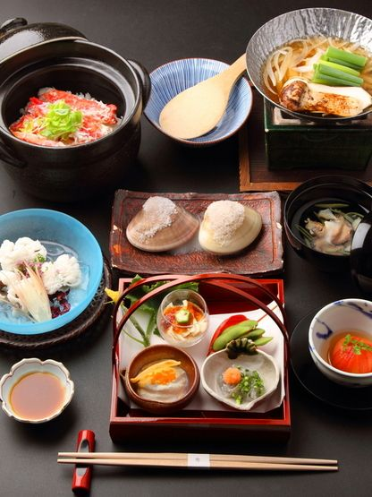 Japanese cuisine is the food—ingredients, preparation and way of eating—of Japan. The traditional food of Japan is based on rice with miso soup and other dishes, each in its own utensil, with an emphasis on seasonal ingredients. The side dishes often consist of fish, pickled vegetables, and vegetables cooked in broth. Fish is common in the traditional cuisine. It is often grilled. Fish may be served raw as sashimi or in sushi.