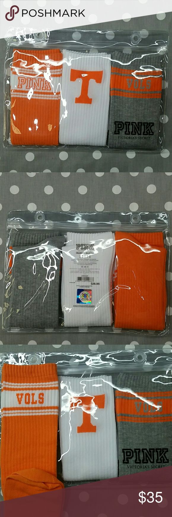 "PINK University of Tennessee Vols Knee High Socks There are three pairs of knee high socks inside of a reusable plastic pouch. They are orange, white, and gray. The orange and gray socks have ""PINK"" and ""VOLS"" (Volunteers) at the top, and the white pair has the ""T"" (for Tennessee or UT) at the top. The sticker on the back of the pouch can be removed and is just a clear pouch with the PINK logo on the bottom corner. They're part of PINK's Collegiate Collection for the University of Tennessee…"