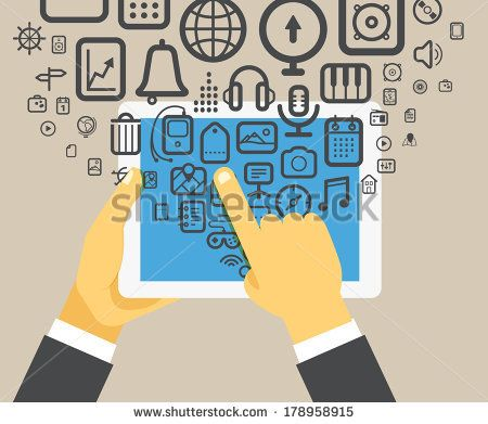 businessman holding modern digital tablet device by tovovan, via Shutterstock