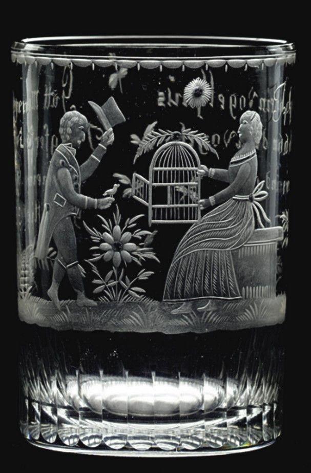 A Bohemian engraved allegorical beaker circa 1805 the cylindrical form decorated with a man doffing his hat to a seated lady holding an open birdcage, inscribed on the reverse Ich hab ein Vogelhaüs  da kan dein Vogel ein und aus and Gutt Morgen Jungfer fürwi z der meinige heift ftigliz, above a band of narrow flutes  11.3cm., 4 3/8 in.
