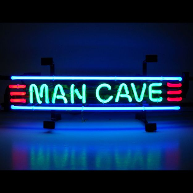 """A Sign That Proclaims """"YOU ARE NOW ENTERING MAN CAVE"""" 
