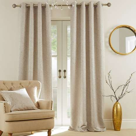 Crafted with a sophisticated textured effect, these ready made eyelet curtains feature a champagne natural shade, fully lined and available in a choice of sizes...