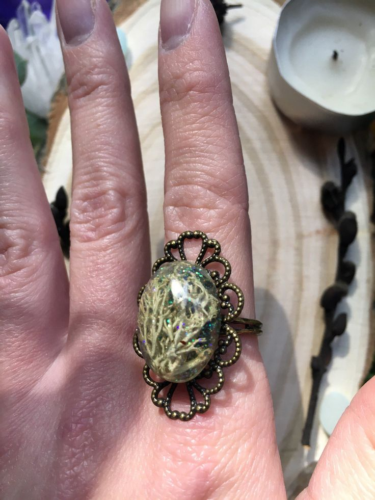 Magic vintage ring Ring with real moss in resin. With glitter inside.The size of the ring is regulated.