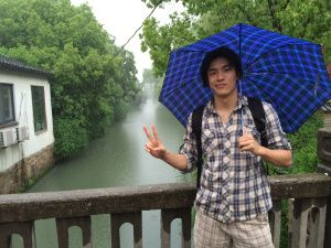 Gator Alex braves the rain while exploring Suzhou, China.