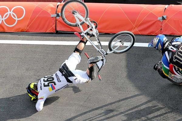 Colombia's Carlos Mario Oquendo Zabala crashes during a BMX cycling men's quarterfinal run