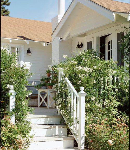 A significant overhaul is worth the cost and time with results like these. Here, designer Nancy Fishelson's tiny stoop was reborn as a woode...