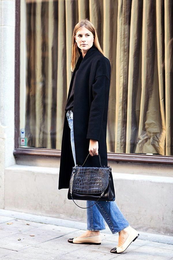 black coat, vintage Levi's jeans, croc-embossed bag and Chanel cap-toe flats #style #fashion