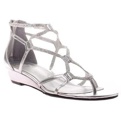 The new TWEEN version of the silver slipper. This shiny silver bedazzled sandal offers great options for any occasion. Perfect for the flower girl / junior bridesmaid, graduation dance or worship service. hannahsshoebox.com