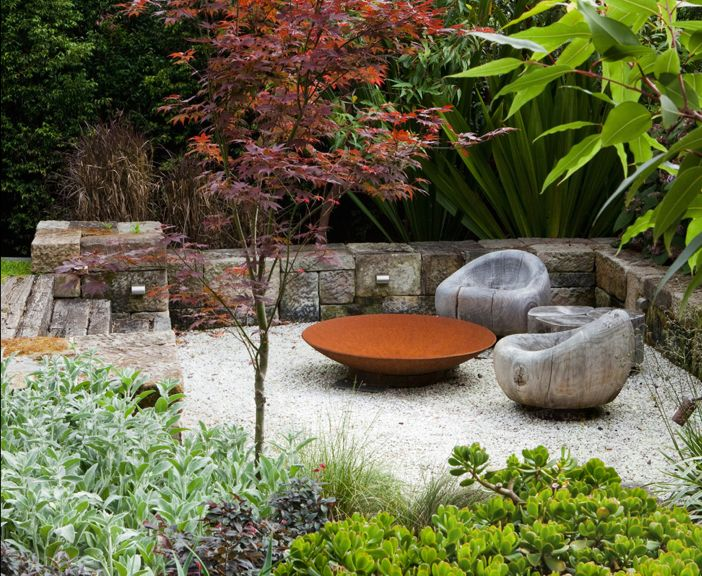 "Stones. Sunken area. Fire pit. : ""Patio designed by Australian firm, Peter Fudge Gardens."""