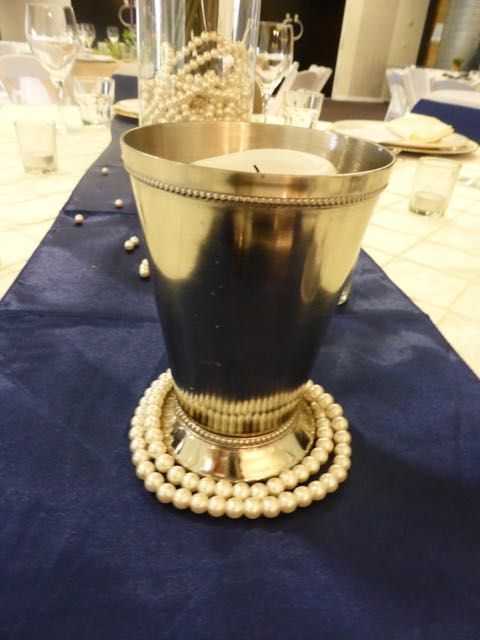 I love this silver vase.  http://www.tailracecentre.com.au/weddings/