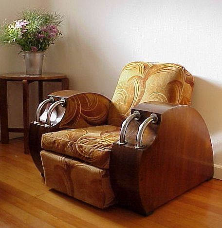 I wonder if this is 1940s. It's cushier than most of the 1930s art deco chairs. the back is way too sloped for me, but it looks cool.