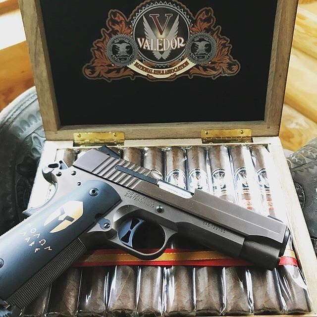 Sig 1911 paired with a box of Rocky Patels | @rwrepp #cigarsandguns #cigars #guns #2a #cigarlife #cigarporn #nowsmoking #puffpuffpewpew
