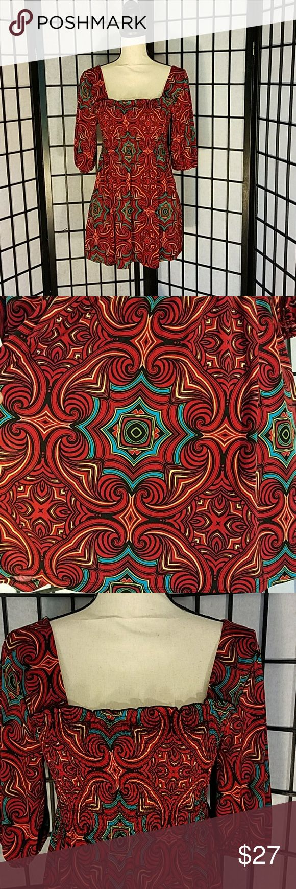 """Bisou Smocked Boho Mandala Mini Dress EUC This can be a mini dress or tunic, up to you and your length preference. Colors are red, yellow, green, blue, black and I swear I see some white in there. It's definitely a stand out pattern. 95% Polyester, 5% Spandex. It's smocked from bust to waist. Sleeves are 12 and half inches with elastic at the end. Armpit to armpit is 14"""", Length from bust line to Hem is 22 and half inches. Bisou Bisou Dresses Mini"""