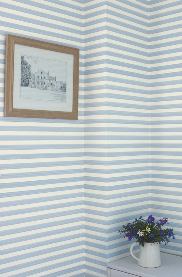 Hallway decoration tip: Give traditional striped designs a contemporary twist by hanging the wallpaper horizontally, like Closet Stripe from Farrow & Ball. Find more ideas and inspiration at housebeautiful.co.uk